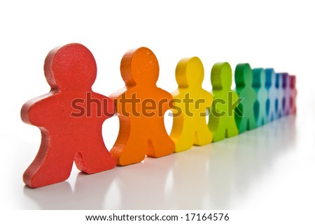 Long line of brightly colored wooden people isolated on a white background. - stock photo
