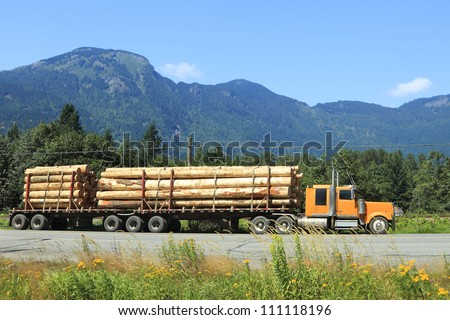 Long logging truck - stock photo