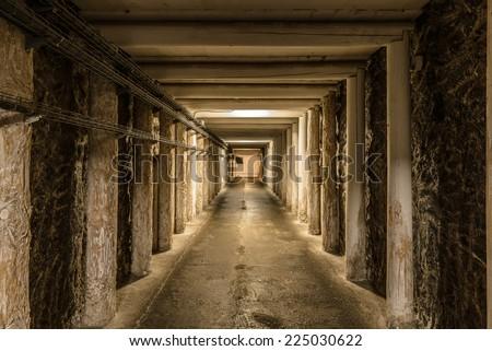 Long mineshaft hallway with wood support beams. Wieliczka Salt Mine - Krak�³w, Poland. - stock photo