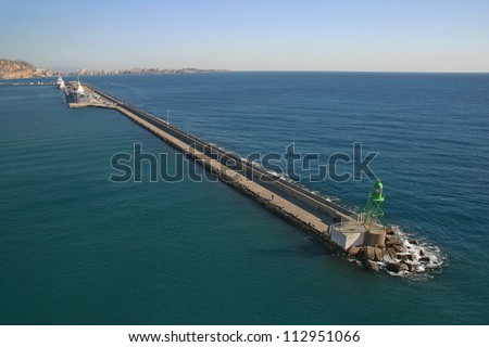 Long pier for ships at the top of the lighthouse - stock photo