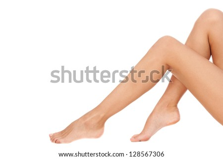 Long pretty woman legs, isolated on white.