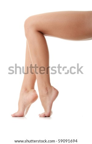 Long pretty woman legs isolated on white