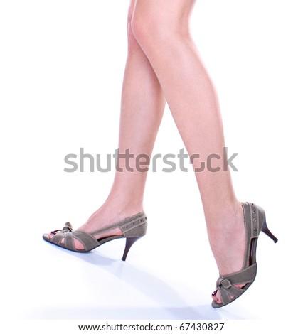 Long pretty woman legs on hills , studio shot - stock photo