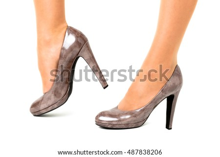 Long pretty woman legs on white background