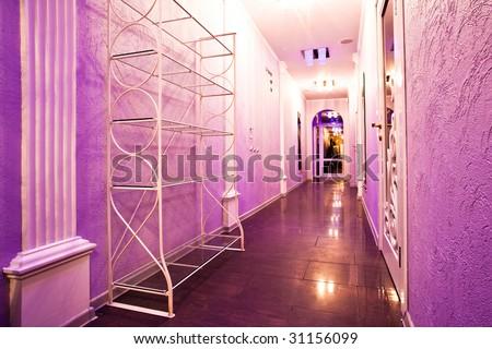 Long purple corridor in barbershop interior with mirrors - stock photo
