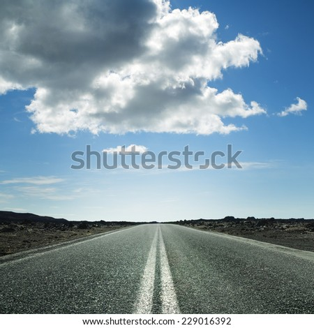 Long road on a sunny day - stock photo