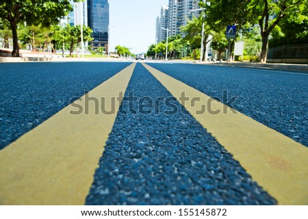 long road stretching out in a Chinese city. - stock photo