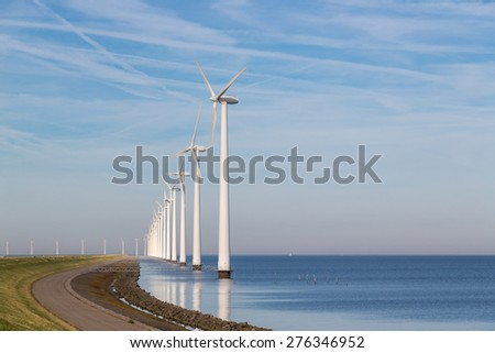 Long row off shore wind turbines along the Dutch coast