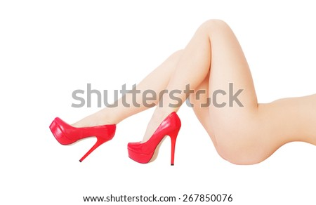 Long sexy woman legs in shoes on white background with a lot of copyspace - stock photo