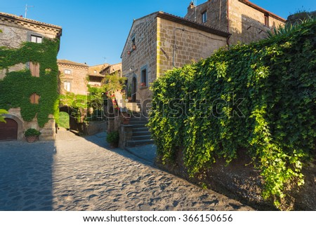 Long shadows of the old walls in the village Civita di Bagnoregio, Italy
