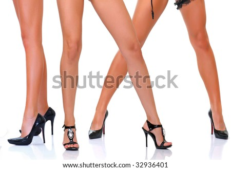 Long slim beautiful female feet in footwear, isolated on a white background, please see some of my other parts of a body images - stock photo
