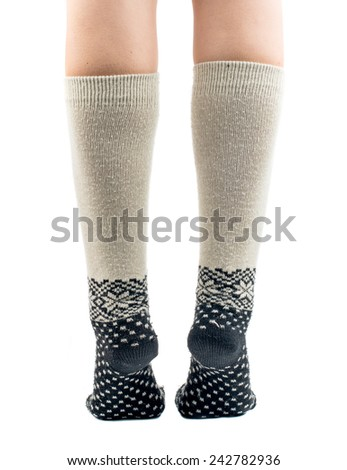 long socks on his feet on a white background - stock photo