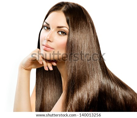 Long Straight Hair. Beautiful Brunette Girl isolated on white background. Smooth and Shiny Brown Hair. Beauty Model Woman. Healthy Skin, Hair and Nails - stock photo