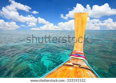 Long tail boat at blue sky and sea.Thailand. Summer background. - stock photo
