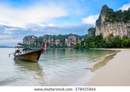 Long Tail boat float on railey beach in morning Krabi Thailand - stock photo