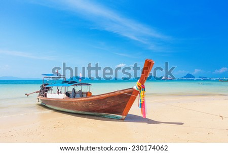 Long tail boat on tropical beach, Krabi, Thailand - stock photo