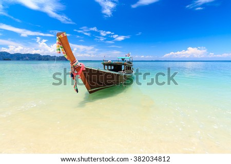 Long tail boat on tropical beach, poda island, Krabi, Thailand - stock photo