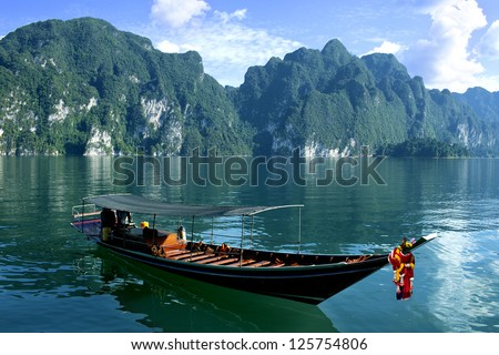 Long tail boat on tropical sea in Thailand - stock photo