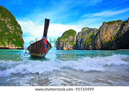 Long tail boats in Maya Bay, Koh Phi Phi Ley, Thailand. The place where the movie the Beach was filmed - stock photo