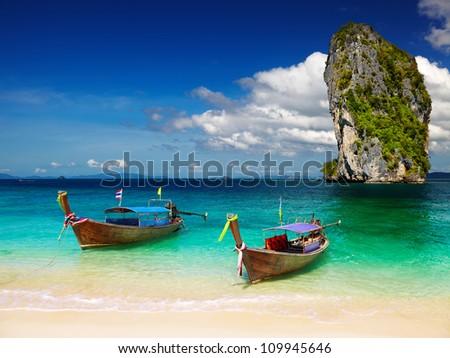 Long tail boats, Tropical beach, Andaman Sea, Thailand - stock photo