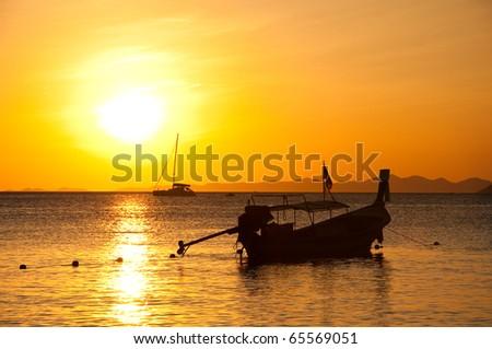 Long tailed boat at sunset , Ao Nang beach, south of Thailand - stock photo
