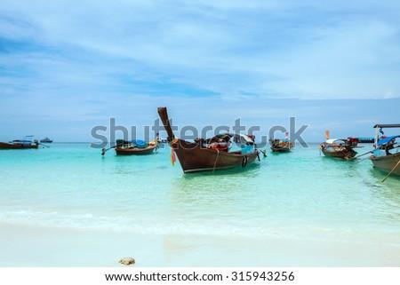 Long-tailed boat on Pattaya beach (Bundhaya) Koh Lipe in Thailand - stock photo