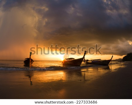 Long tailed boat Ruea Hang Yao at sunset in Krabi Thailand - stock photo