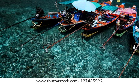 Long-Tailed Boats in Clear Water, Suratthani, Thailand. - stock photo