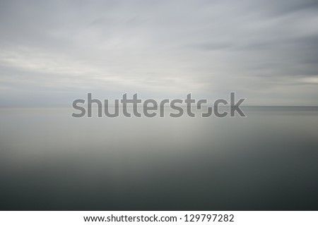 long time exposure of the ocean, soft water and cloudy sky - stock photo
