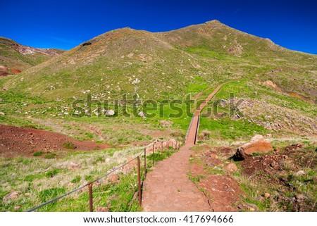 long walking path leading to the Ponta de Sao Lourenco, the eastern part of Madeira, Portugal - stock photo