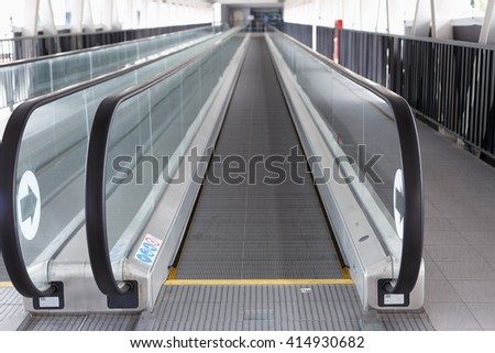 long walkway of escalator at Building in Thailand - stock photo