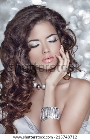 Long wavy hair. Beautiful brunette woman with sensual lips, makeup, hairstyle - stock photo