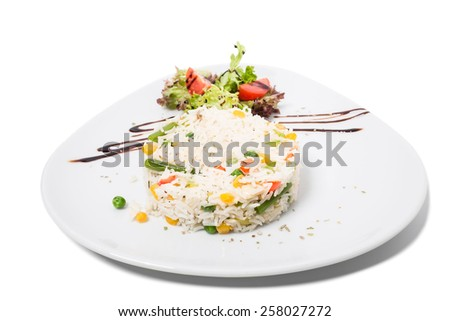 Long white rice with sauce and vegetables. Isolated on a white background.