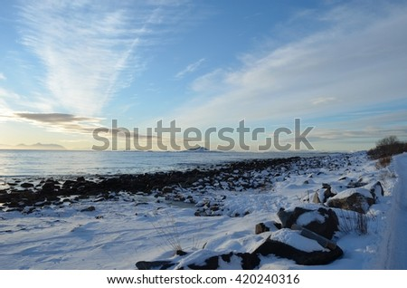 long white snowy sea shore with open seas in the background