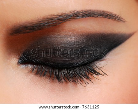 Long woman eyelashes brushing black mascara. - stock photo