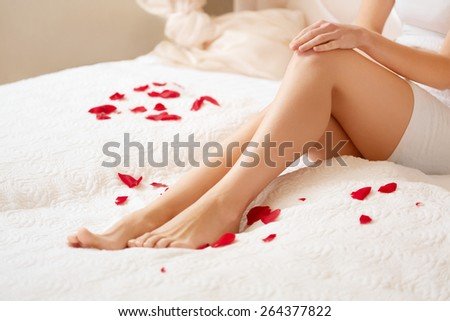 Long Woman Legs. Beautiful Woman Cares About Legs. Depilation - stock photo
