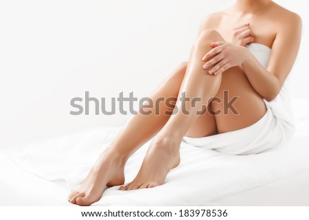 Long Woman Legs isolated on white. Epilation - stock photo