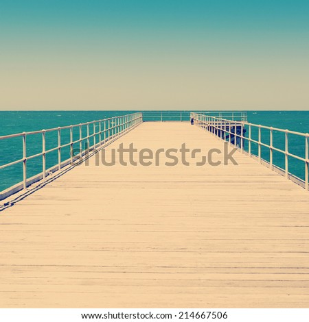 Long wooden jetty stretches out into clear water at Stenhouse Bay, South Australia - stock photo