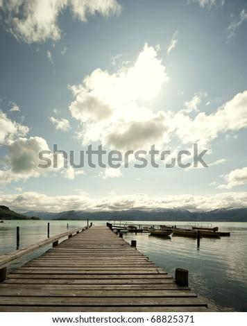 Long wooden pier at hardangerfjord - stock photo