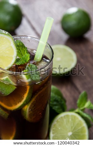Longdrink in a glass on wooden background - stock photo