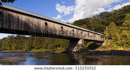 Longest covered Bridge in Brattleboro Vermont over the West river. - stock photo