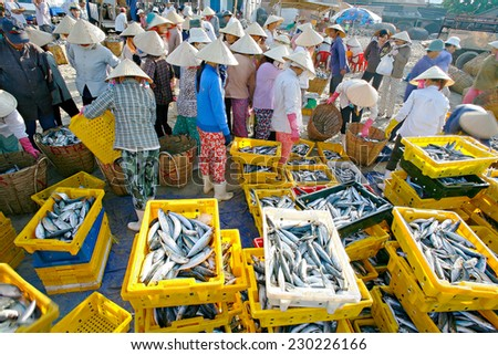 LONGHAI,VIETNAM - MARCH 22, 2009:A traditional fish market on the beach on March 15, 2008 in Long Hai town, Baria - Vung Tau province, Southern of Vietnam. This market only happens in early morning.  - stock photo