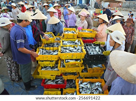 LONGHAI,VIETNAM MARCH 22, 2009:A traditional fish market on the beach on March 15, 2008 in Long Hai town, Baria - Vung Tau province, Southern of Vietnam. This market only happens in early morning.   - stock photo