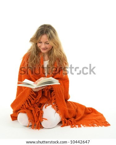 Longhaired girl reading a book, smiling. - stock photo