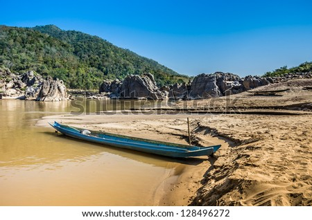 Longtail Boat on Mekong River, Laos - stock photo
