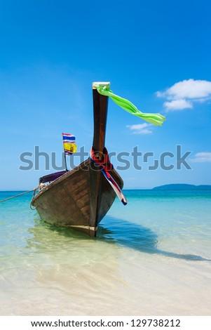 Longtail boat on the beautiful beach - stock photo