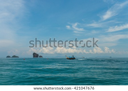 Longtail boat with Poda island background at Krabi. Poda is famous island travel package tour by traditional longtail boat at Krabi, Andaman ocean Thailand