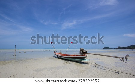 longtail boats with blue sky. - stock photo