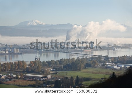 Longview, Washington State, Mount St. Helens. Longview, Washington State, USA. The Lewis and Clark Bridge. The top of Mount St. Helens in the background.   - stock photo