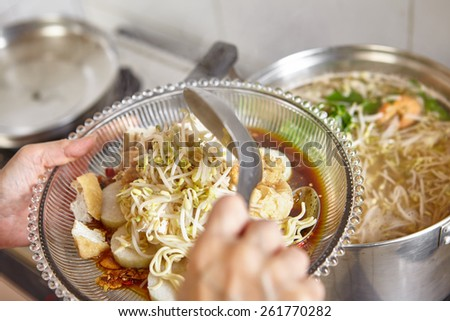 Lontong mie in Indonesian for its famous traditional food, or in English maybe spelled rice cake and noodle in vegetable soup - stock photo